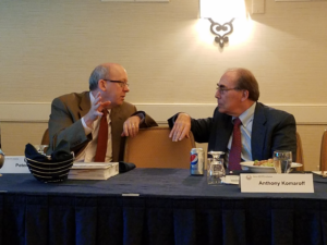 Dr. Peter Rowe, pictured above working with Dr. Anthony Komaroff at an SMCI Research Advisory Council meeting.